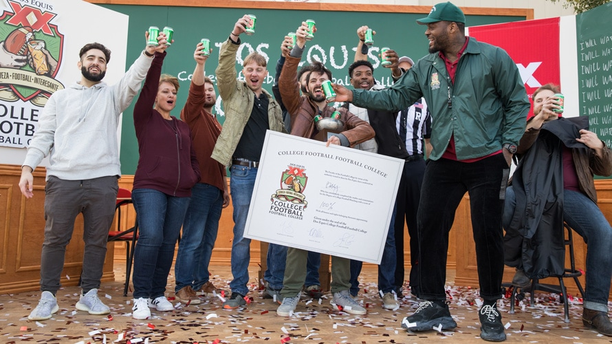 Football star Martellus Bennett and fans group photo at the Dos Equis College Football Football College Bowl Game