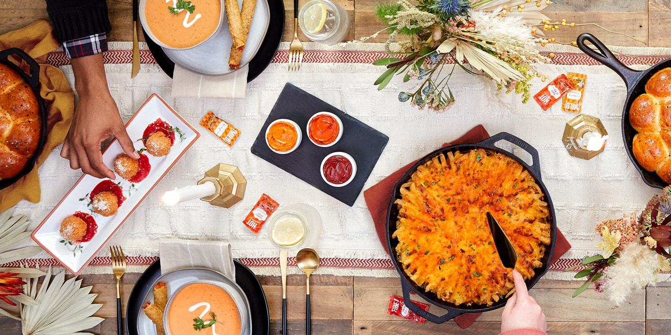 Overhead shot of a Thanks giving dinner with food from Taco Bell