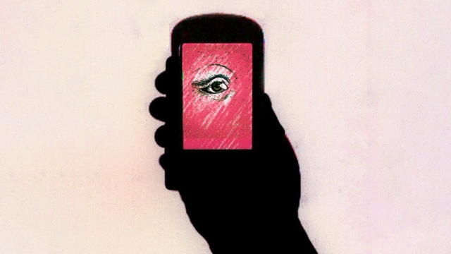 silhouette of hand and phone with an eye on the screen
