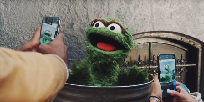 People taking pictures of Oscar the Grouch from Squarespace ad