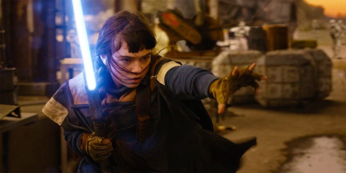 A young woman dressed as a Jedi uses a lightsaber with her other hand outstretched