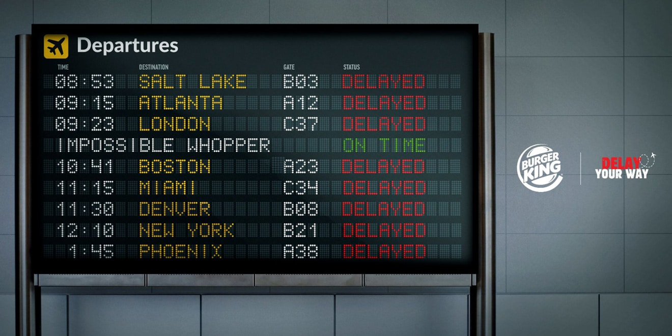 a screen of incoming flights at an airport with delays and one on time