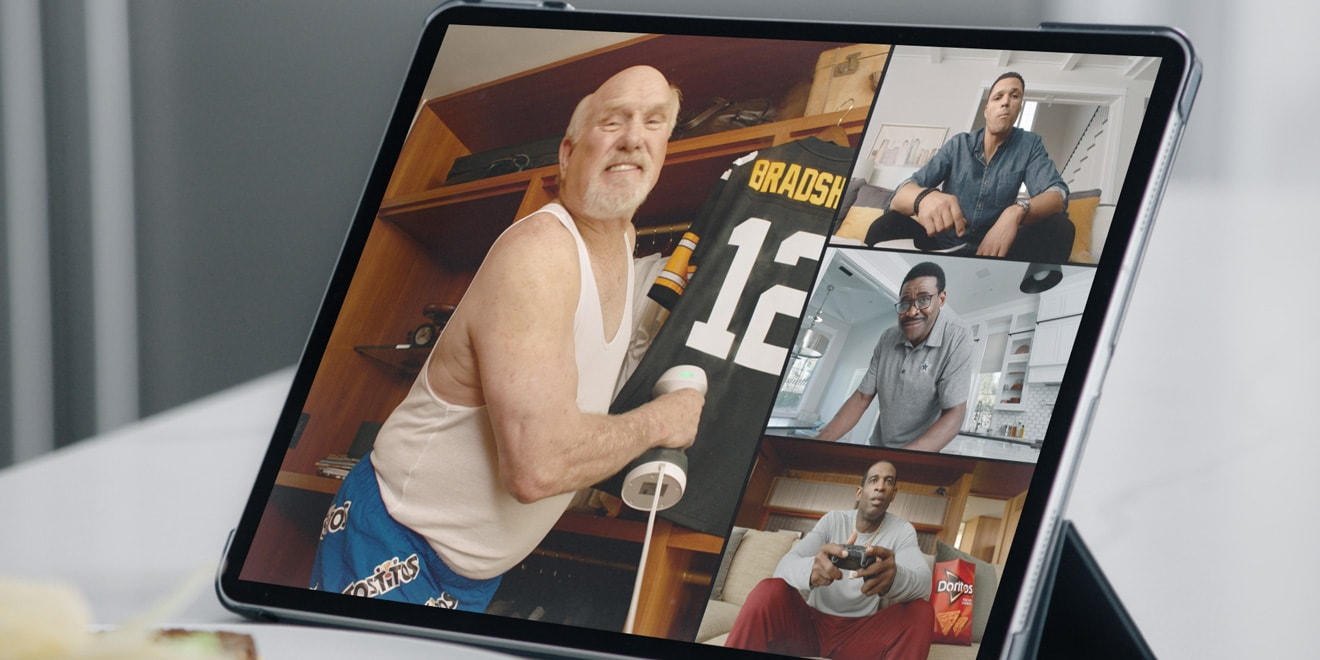 Terry Bradshaw, Tony Gonzalez, Michael Irvin and Deion Sanders on a tablet screen
