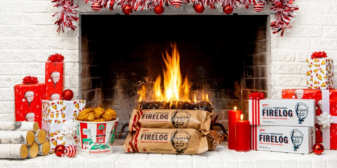KFC fried chicken scented firelogs sit in front of a festive fireplace