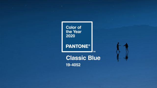 """An image of two people in the distance with text that says """"Color of the Year 2020,"""" """"Pantone"""" and """"Classic Blue 19-4052"""""""