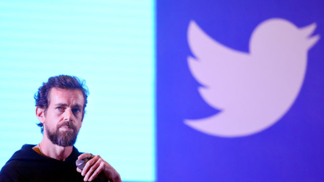 Picture of Jack Dorsey and Twitter logo in the background