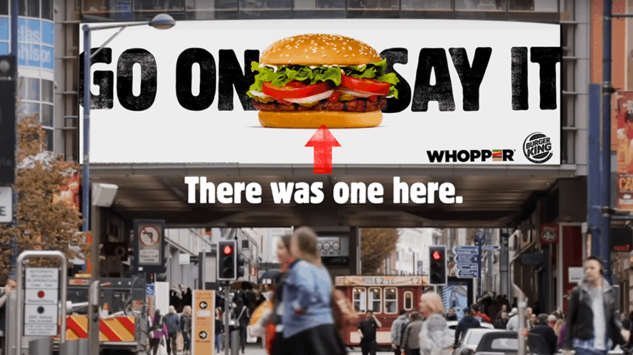 a sign with a whopper and an arrow pointing down that says there was one here