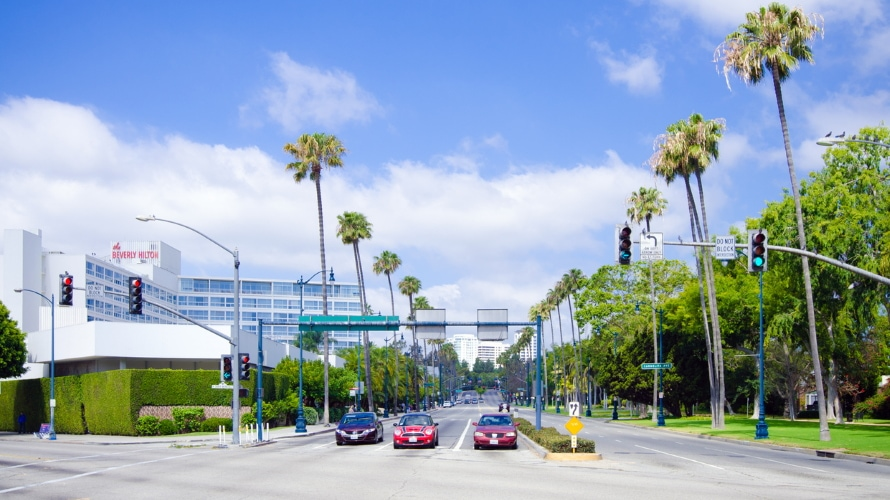 Shot of a street with the Beverly Hilton on the left