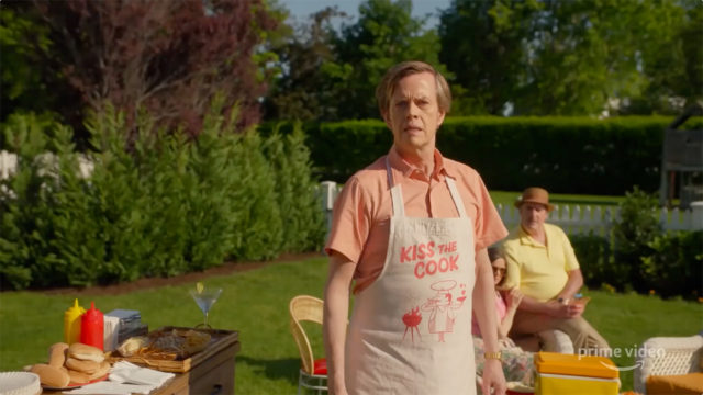 a man in an apron in a backyard