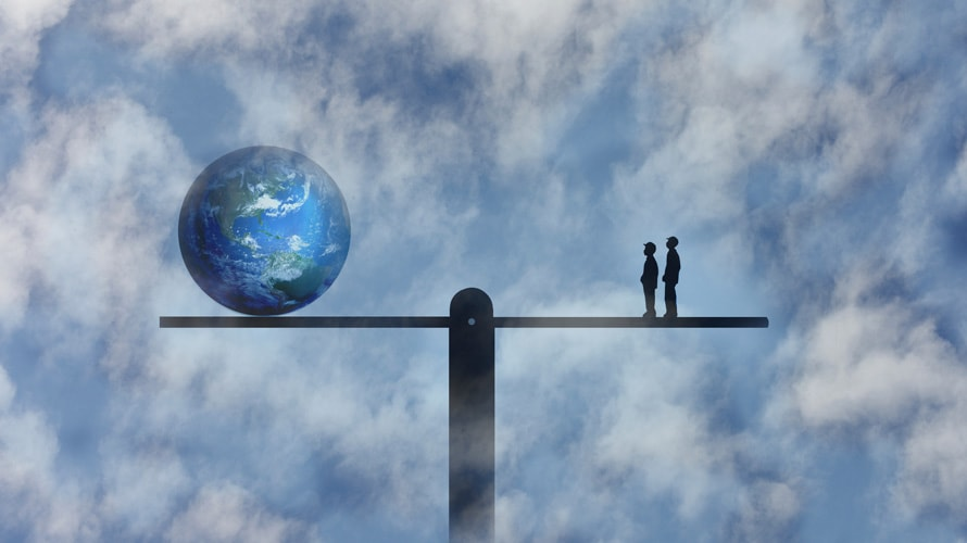 Conceptual illustration of two people on one side of a seesaw and planet earth on the other