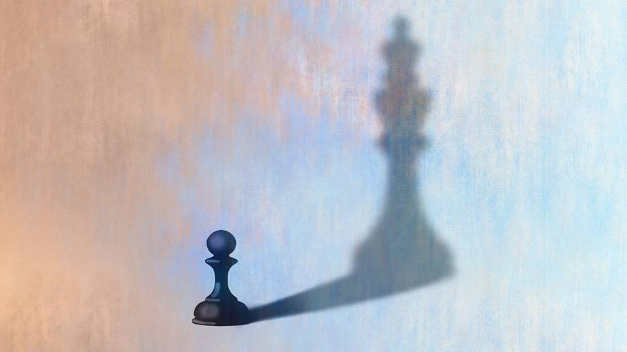 A pawn with a shadow of a king