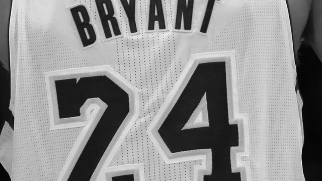 A black and white close-up of Kobe Bryant's jersey