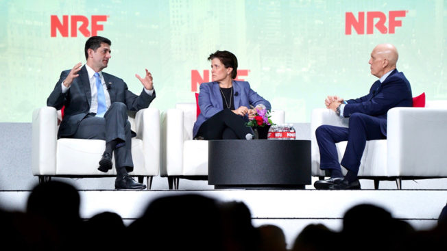 paul ryan, left, on stage at the national retail federation's conference