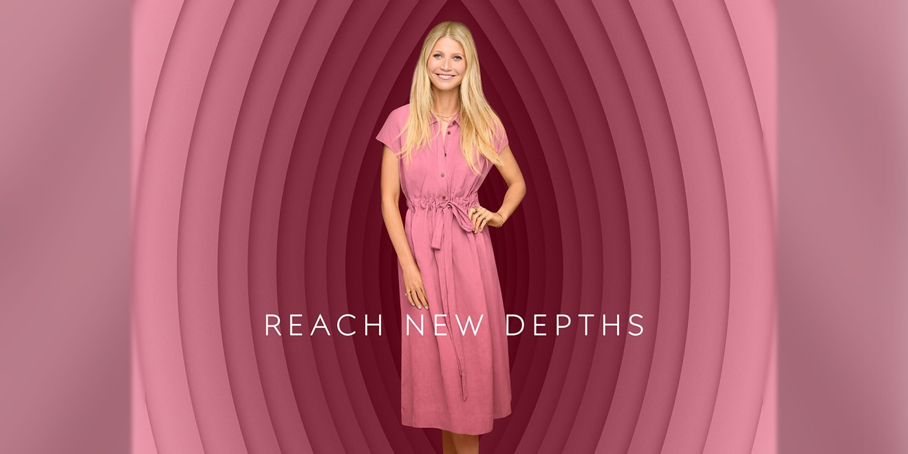 gwyneth paltrow standing in front of a bunch of circles