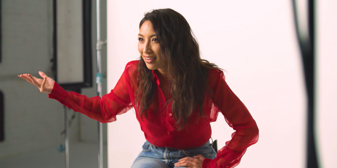 TV host Jeannie Mai gestures in frustration to a camera during an interview