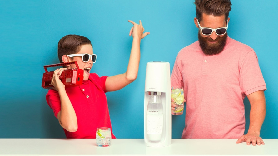 boy and man in sunglasses standing next to SodaStream and listening to music