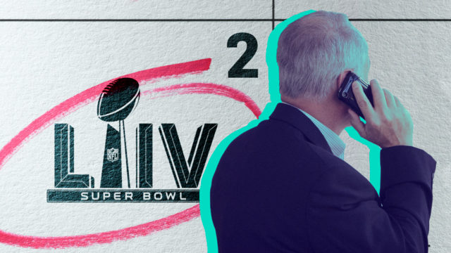 a man on his phone from the back with the super bowl logo to the left