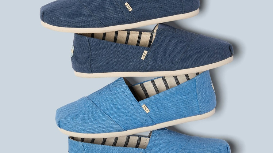a stack of toms shoes