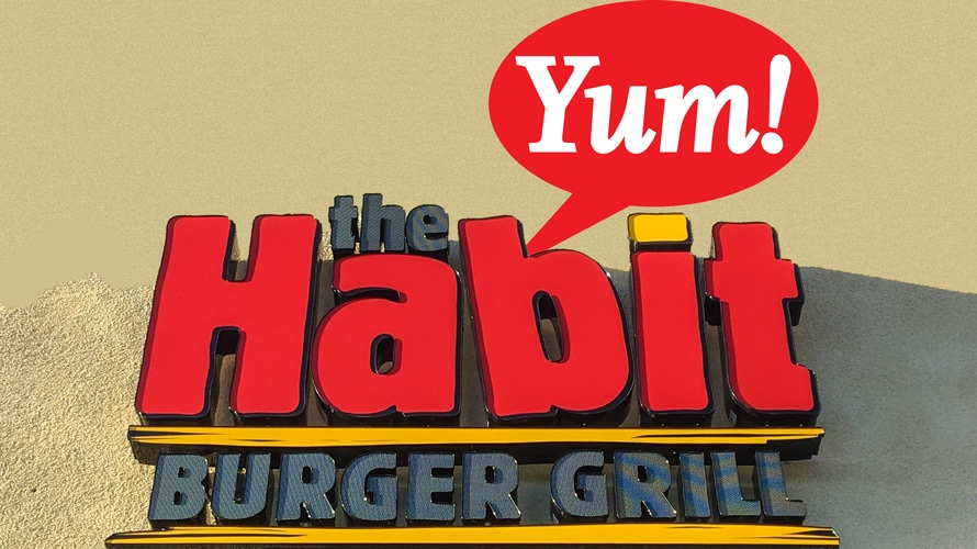 Habit burger signage and Yum! logo