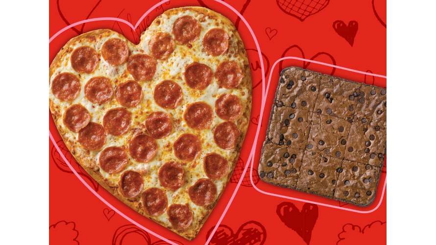 A heart-shaped pizza next to a brownie