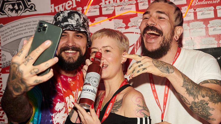Influencers posed in front of branded wallpaper backdrops at the BudX Hotel.