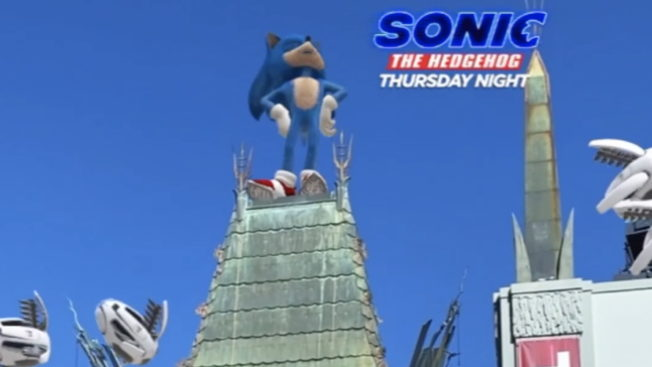 An image of Sonic the Hedgehog on top of a house with text on the right that says,
