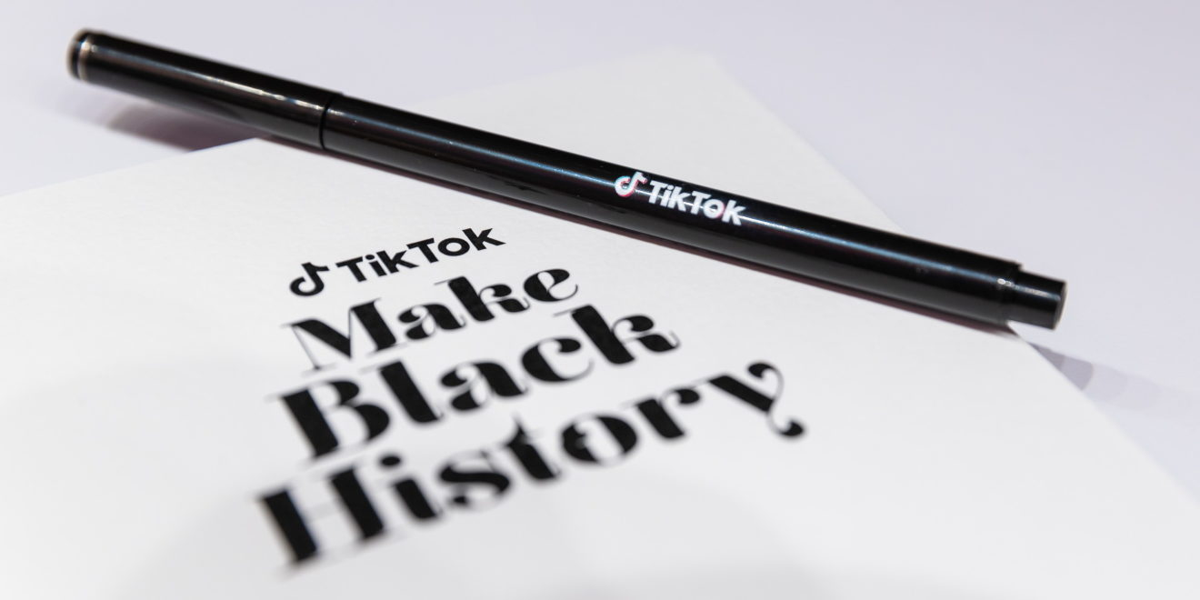 A pen with the TikTok logo on top of a folder that says TikTok Make Black History