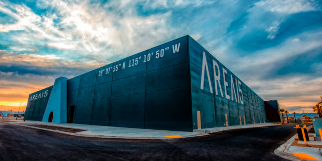 a large blue building that says Area15