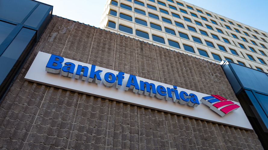 Looking up at Bank of America sign on building