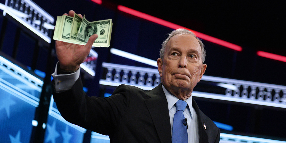 mike bloomberg holding a wad of money