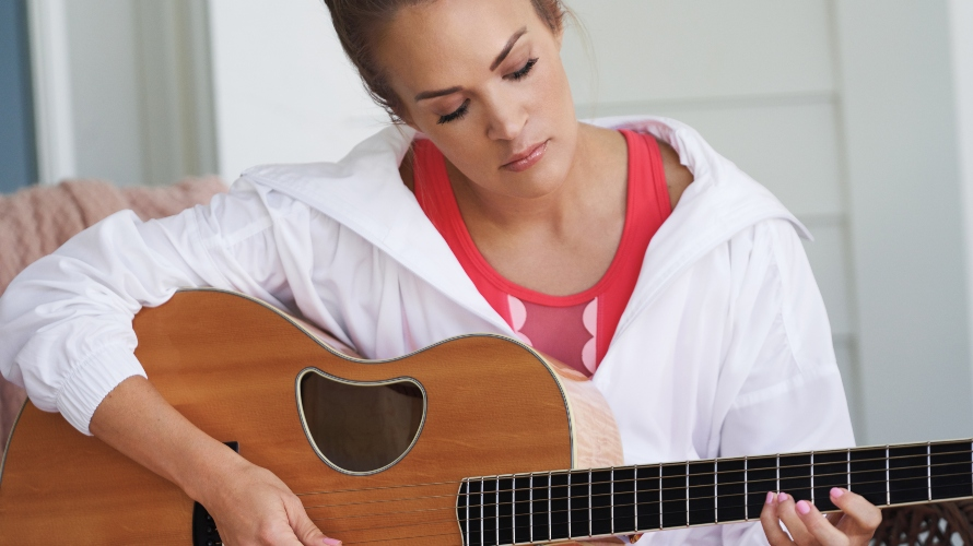 Carrie Underwood playing the guitar
