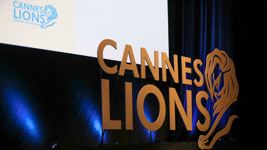 The side of a stage with the Cannes Lions logo