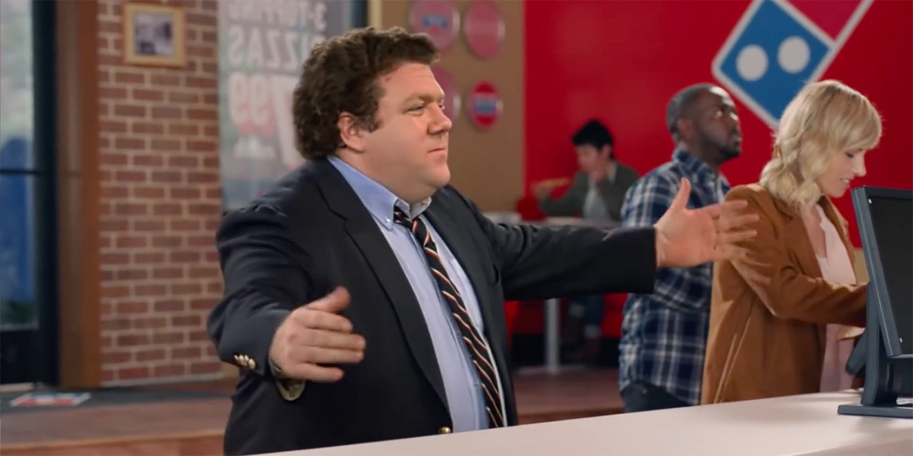 Norm Peterson from Cheers is seen in a Domino's location ordering a pizza