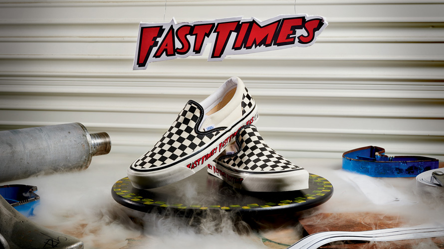 checkerboard vans with Fast Times written above it