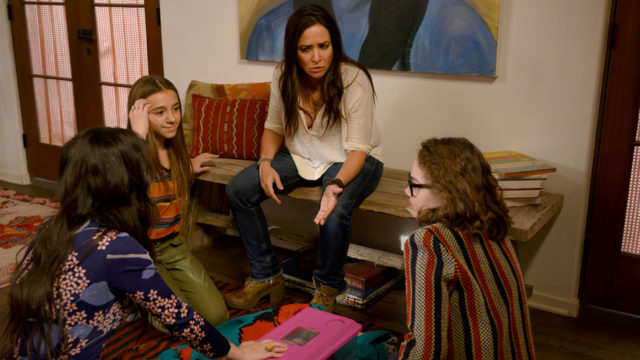 A still of Pamela Adlon from Better Things talking to young girls