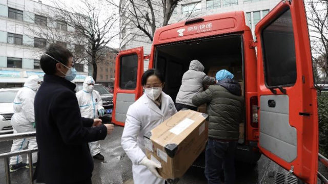 a doctor removing supplies from a van