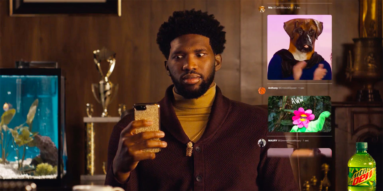 A still of Joel Embiid on his phone looking at GIFs