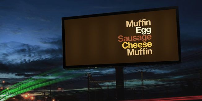 An outdoor ad lists the ingredients of an Egg McMuffin without naming the sandwich