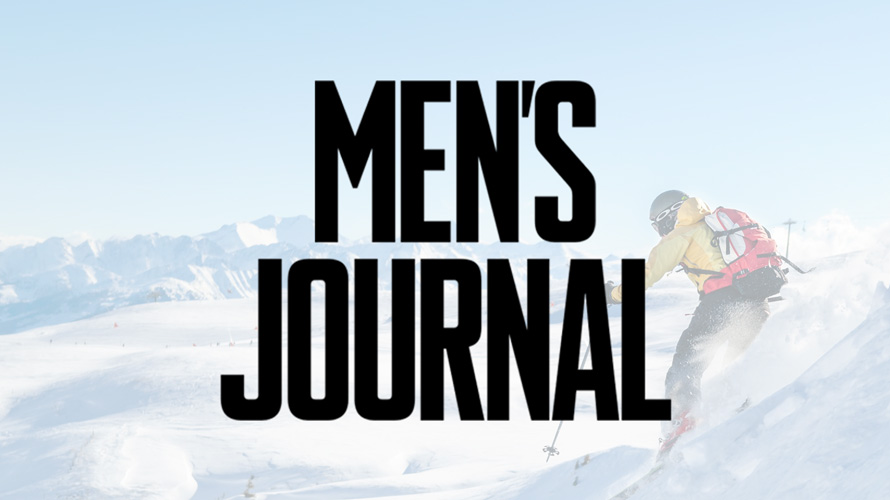 An image of a skier in snow with the Men's Journal logo