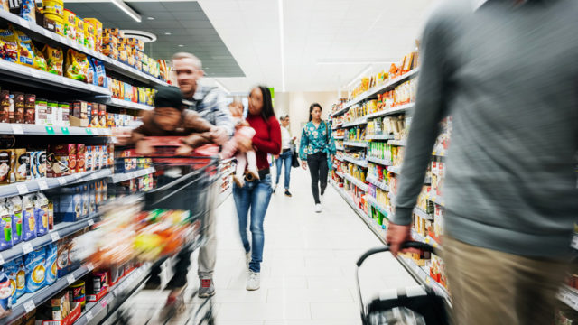 people shopping in a supermarket aisle