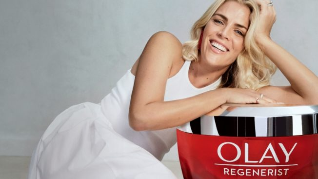 Busy Philipps poses with a large container of Olay.