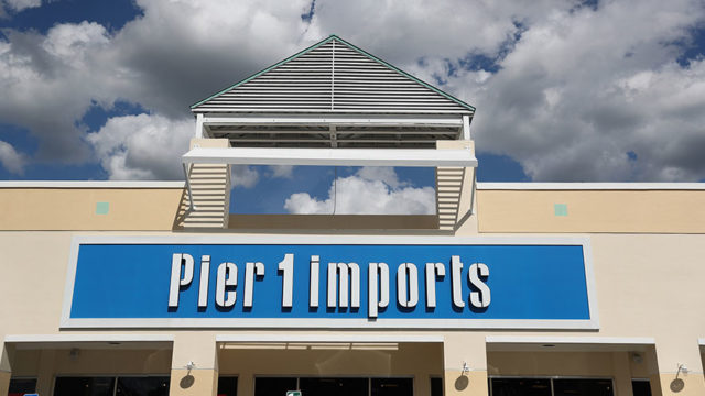 pier 1 imports logo on a storefront