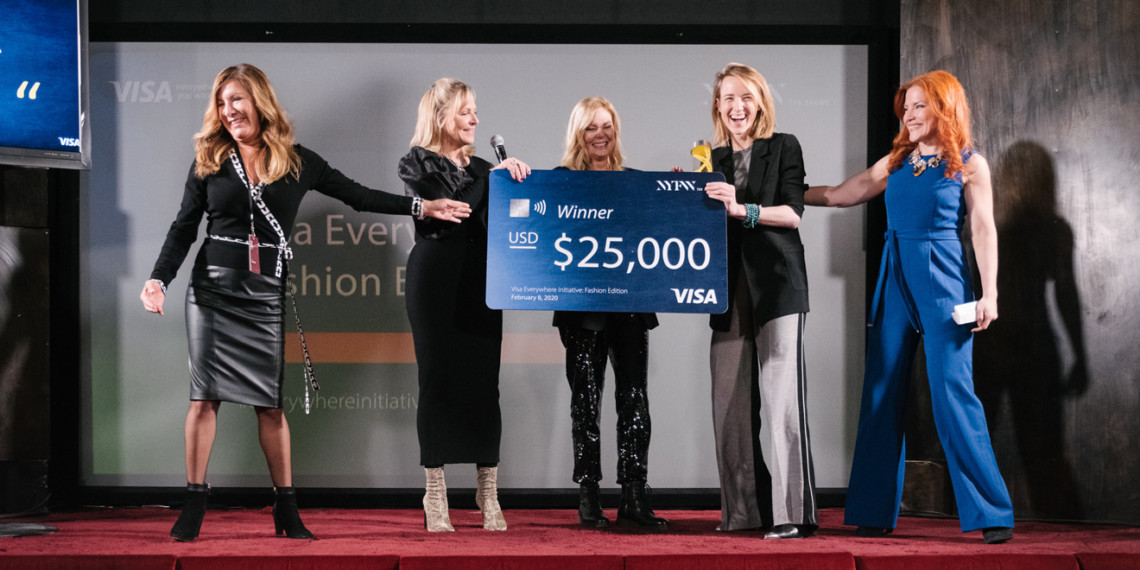 women holding a giant check