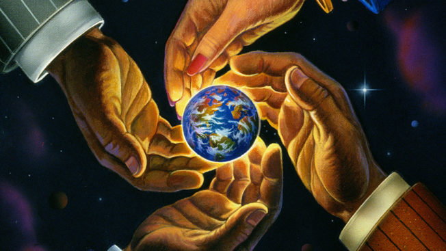 Four hands hovering over a small illustration of Earth