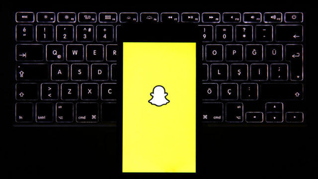 a yellow screen with the snapchat logo