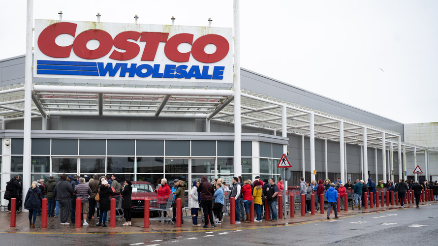 a line of people in front of costco