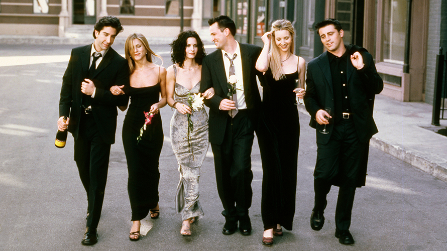 cast of friends all dressed in black with courteney cox in silver