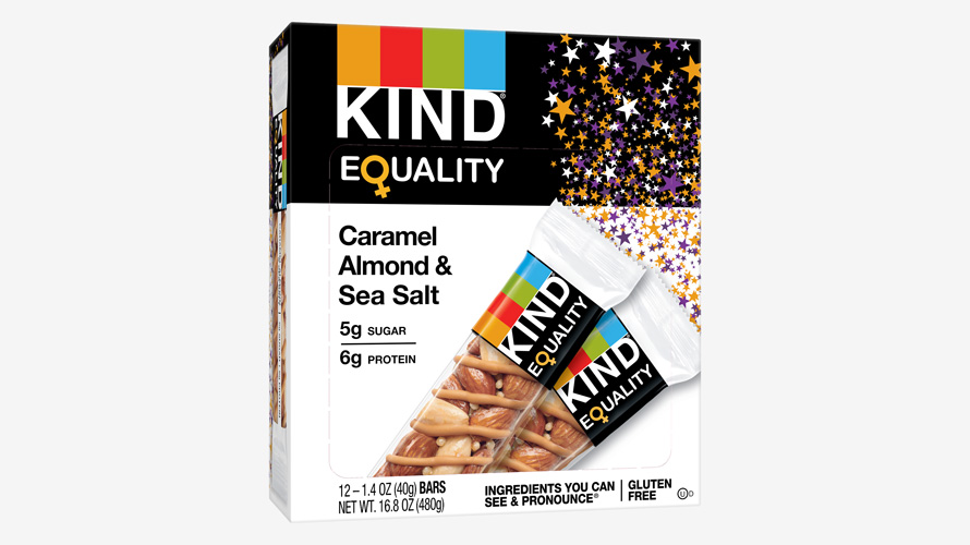 A box of KIND Equality bars features purple, white, and gold stars to celebrate women's suffrage