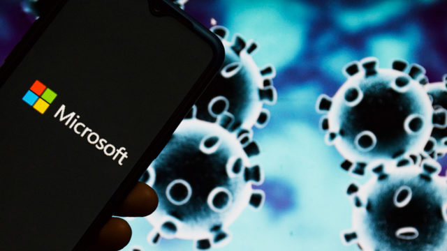 A smartphone with the Microsoft logo next to an image of the coronavirus
