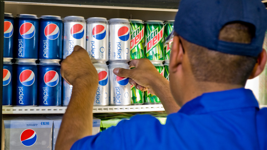 Pepsi products on store shelf.